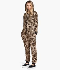 Lounge like a jungle cat in this leopard-print jumpsuit with sweatshirt fabric, drawstring hood, and front zip. | H&M Divided