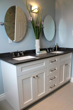 Room Transformations From HGTV's Love It  List It | HGTV  Dark counter top contrasts nicely with white cabinets and gray walls. Gradation of color.