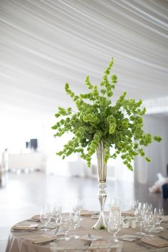 Elegant green floral centerpiece: http://www.stylemepretty.com/illinois-weddings/chicago/2014/11/10/whimsical-chicago-wedding-at-galleria-marchetti/ | Photography: Cristina G - http://cristinagphoto.com/