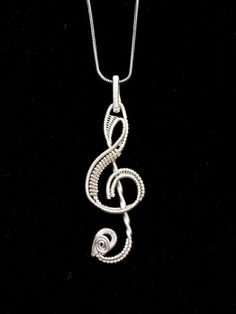 Treble clef pendant featuring a toggle bail  **Includes a 30 inch 1.3mm sterling silver chain (Please message me if you would prefer a different size chain (18,24))  Handmade with sterling silver wire  2 inches in length  USPS Priority Mail