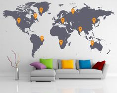 Picture of dark grey world map with yellow pins