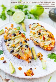 Cheese, Black Beans, and Corn-Stuffed Sweet Potatoes with Avocado Crema (vegan, GF)