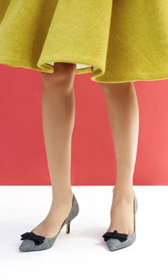 Classic mid heel pumps with a charming bow and pointed toe.