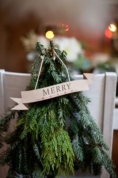 Xmas tree branches turned chair decor // photo by Nine Photography, event design by Grit + Gold http://ruffledblog.com/winter-woodland-wedding-ideas/ holiday, xmas tree, turn chair, tree branches, christmas wedding, christma branch, woodland christmas, christmas trees, chair decor