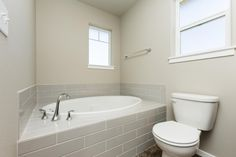 Winslow Master Drop In Garden Tub With Standard 4x16 Subway Tile On Deck  And Back
