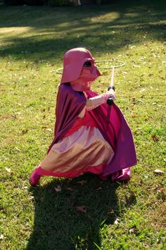 Awesome dad does good by his kid and comes up with this for a Halloween costume: Pretty Pink Princess Vader.
