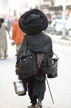 Sadhu in all black and big turban. Biggest I've ever seen. October 2014, Pushkar. ------ ig| twitter