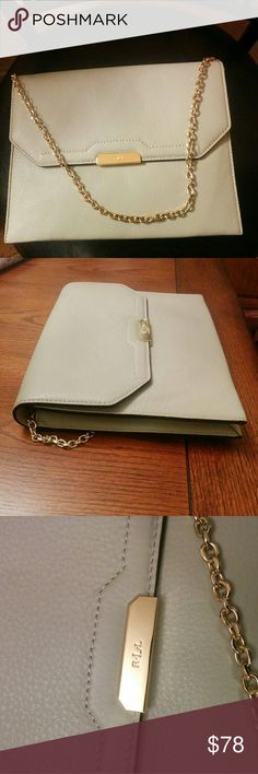"""🆕Ralph Lauren neutral clutch/shoulder bag This elegant neutral color pebble leather clutch/shoulder bag is easy to match . Chain shoulder strap  8.5"""" drop.Fold-over flap.Signature """"LRL"""" monogram at the front.Fully lined. One zip pocket and one slip pockets at the interior. 8"""" H x 10.5"""" L x 1.5"""" D. The color is very light grey-beige ( called greige in fasion industry).  Very elegant and classy clutch for a special occasion or just a night out. NWOT. Ralph Lauren Bags Clutches & Wristlets"""