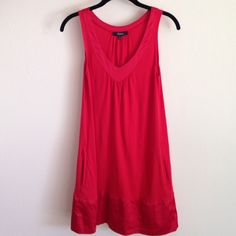 "Express Dress Express dress that has satin trim around the bottom and around the v-neck. Dress also has side pockets. It's 100% rayon. From the top of the straps it measures 32 1/2"" long. Could also wear as a tunic over leggings too. Great condition!!!!! Express Dresses"