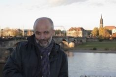 Smiling bald middle-aged man on the background of the Elbe in Dresden Stock Photo