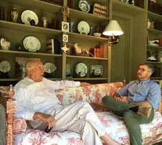 Furlow Gatewood in his home - beautifully styled shelves, green walls, red toile