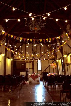 Crossed strands of festoon lights for this fun, colourful wedding