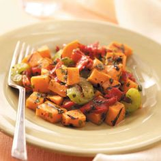 Grilled Sweet Potato and Red Pepper Salad - This recipe combines vibrant colors and tastes to create an unusual salad. It's an exciting accompaniment to any entree sizzling on the grill.