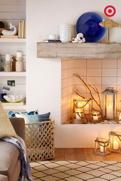 Cluster a few lanterns, light the candles and enjoy cozying up to the fireplace in spring. It's the perfect warm-weather fire in any living room.