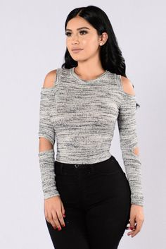 - Available in Charcoal and Rose - Knit Top - Cold Shoulder - Round Neckline - Ribbed - Elbow Cut Out - Made in USA - 48% Rayon 48% Polyester 4% Spandex