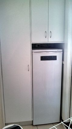 Was an old cupboard here turned it into a freezer space and storage!