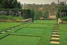 Harpur Garden Images :Sunken squares in lawn. Grass. Borders of Agapanthus infront of hedges. Design: Vladimir Sitta, Garangula , Harden,