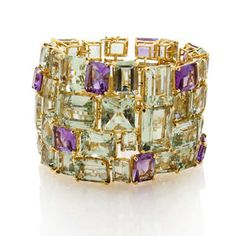 A green quartz and amethyst bracelet by Tony Duquette.  The wide bracelet is designed with various sizes of rectangular and square-cut green quartz accentuated by intermittent rectangular-cut amethyst;  mounted in eighteen karat gold;