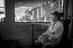 An old granny watching the world passing by when crossing Rosenthaler Platz by tramway