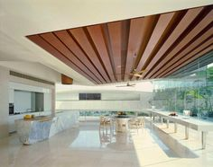 grate wood ceiling & stone kitchen island