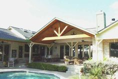 Here's a covered patio that leads to a swimming pool.