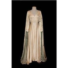 """Ecru silk medieval gown with rabbit and ermine trim from Vagabond King. (Paramount, 1930)  Worn by Jeanette MacDonald as """"Katherine"""" in the scene where she thanks Dennis King for ordering out the enemy in Vagabond King."""