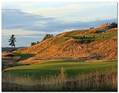 """Swing""....golfers ""swinging"" for hole 17 of Chambers Bay Golf Course, University Place, WA."