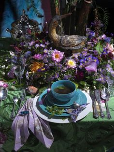 Mad Hatter's Tea Party -- This is the Tea Party scene that I have been wanting to portray in my version of Alice in Wonderland; cluttered, nature-filled, and set in a dark place (such as the dark blue background and the darkened color, as if they were having a tea party in the middle of the night). Also, the color scheme matches with Alice's blue dress as well as parts of the Mad Hatter's and the Cheshire Cat's purple costume/fur color.