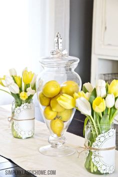 For an easy DIY Easter centerpiece, use twine to wrap a doily around a Mason jar, and fill with tulips. A bowl of lemons completes a colorful, spring-inspired table.