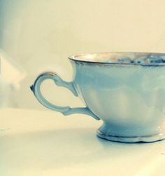 turquoise and gold tea cup. ok.