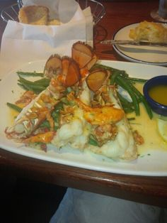 Delish! Topped Lobster Roasted split Maine lobster tails over mashed potatoes and fresh green beans, topped with sweet lobster meat in a lobster beurre blanc.