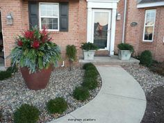 Easy landscaping for front porch area...low maintenance!  This is what I need!!!