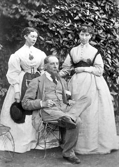 Katey and Mamie Dickens, with their famous author father Charles Dickens  garden outside Gad's Hill Place in 1865