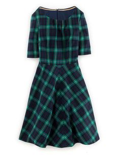 Beautiful green plaid wool dress with elbow sleeves and a full skirt. YES, THANK YOU.