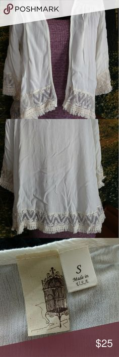 Light Weight Shall Cream shall from Francesca's collections goes great over spring and summer dresses. Perfect for wedding season. Beautiful lace and fringe trim around bottom and cuffs. Francesca's Collections Accessories Scarves & Wraps