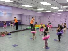 The Ballerina Girls and American Girl Doll Isabelle by the Floor Balance Beam at Ballet,Tap and Baton Class at Vicki Michelle Dance Studio.