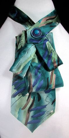 A one of a kind unique creation giving an old tie a new lease of life - carefully folded and hand stitched into a design and then embellished with just