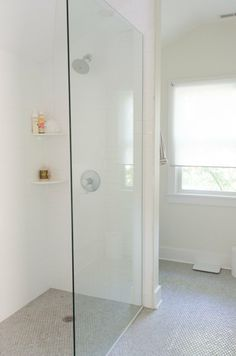 love this rimless shower:  Faith & Mike's Master Bathroom: The Big Reveal Renovation Diary | Apartment Therapy