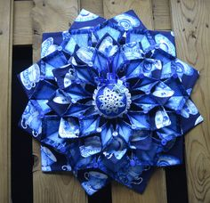 19 foldn stitch wreath done is shades of blue with a pretty tea cup print accented with a quilted ball. Quilting Projects, Sewing Projects, Sewing Ideas, Quilted Christmas Ornaments, Christmas Crafts, Fabric Crafts, Sewing Crafts, Fabric Flowers, Silk Flowers