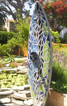 outdoor surfboard shower,  I like this mosaic pattern...