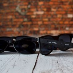 Black frame Wayfarer style sunglasses favors with personalized stickers on arms