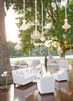 All white lounge furniture and hanging crystal chandeliers will up the elegance factor at your celebration. 10 Lounge Areas That Will Totally Make Your Wedding