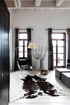 Black And White Cow Rug - Since its principal uses are for food prep and dish washing machine, A kitchen always tends to b Cowhide Decor, White Cowhide Rug, White Rug, Black White, Cowhide Pillows, Living Room Carpet, Rugs In Living Room, Living Room Decor, Dining Room