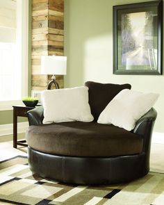 LOVE LOVE LOVE this oversized swivel chair from Ashley Furniture  Home Store - I love the chocolate color too.  Looks super comfy!!!   <3