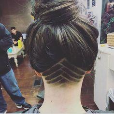 Undercut shaved lines, high bun. Exquisite.