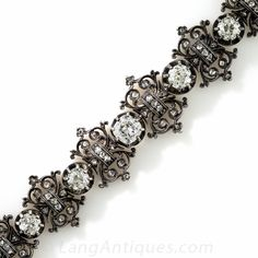 French Antique Diamond Bracelet. Suitable for early-to-mid-nineteenth century French royalty, this opulent and impressive diamond bracelet, artfully handcrafted in darkened silver over 18K rose gold, sparkles by sun or candlelight with 12 gorgeous old mine-cut diamonds. The main diamonds, which total over 6 carats, alternate with fanciful links dotted with glittering rose-cut diamonds. A rare and ravishing antique jewel stamped with French hallmarks. 7.40 carats total diamond weight,