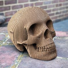 The Vince Human Skull by Cardboard Safari is a sculptural skull made of recycled cardboard. The skull consists of laser-cut cross sections that ship flat for at-home assembly. It is available in mi...
