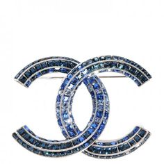 This is an authentic CHANEL Crystal Baguette CC Brooch. This radiant brooch is a large, silver Chanel CC logo with a criss-crossing CC.