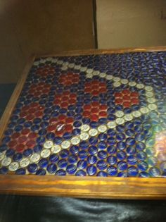 Great idea for a beer pong table. Made out of bottle caps.