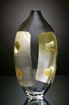 FRED KAEMMER - Uses traditional decorative elements of glassblowing in unorthodox ways, creating unusual textures or patterns and against the grain of conventional glass decoration. Most decorative elements are added to the surface or between layers of glass. This creates a piece that is meant to be viewed from only one direction. Working on interior surfaces engages the viewer more fully, edging  away from utilitarian and traditional foundations and to a sculptural and interesting work of…